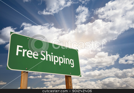 Free Shipping Green Road Sign stock photo, Free Shipping Green Road Sign Over Dramatic Sky, Clouds and Sunburst. by Andy Dean