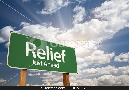 Relief Green Road Sign stock photo, Relief, Just Ahead Green Road Sign Over Dramatic Sky, Clouds and Sunburst. by Andy Dean