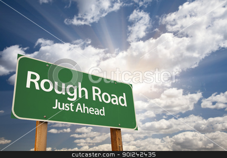 Rough Road Green Road Sign stock photo, Rough Road, Just Ahead Green Road Sign Over Dramatic Sky, Clouds and Sunburst. by Andy Dean