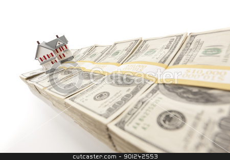 Small House on Row of Hundred Dollar Bill Stacks stock photo, Small House on Row of Hundred Dollar Bill Stacks Isolated on a White Background. by Andy Dean