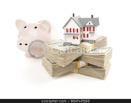 Small House and Piggy Bank with Stacks Money stock photo, Small House and Piggy Bank with Stacks of Hundred Dollar Bills Isolated on a White Background. by Andy Dean