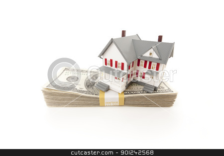 Small House on Stack of Hundred Dollar Bills stock photo, Small House on Stack of Hundred Dollar Bills Isolated on a White Background. by Andy Dean