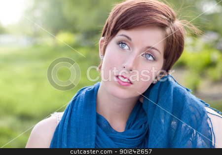 Pretty Blue Eyed Young Red Haired Adult Female Outdoor Portrait stock photo, Outdoor Portrait of Pretty Blue Eyed Young Red Haired Adult Female with Blue Scarf. by Andy Dean