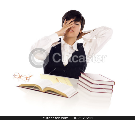 Frustrated Mixed Race Young Adult Female Student At Table stock photo, Frustrated Mixed Race Young Adult Female Student At White Table with Books and Paper Isolated on a White Background. by Andy Dean