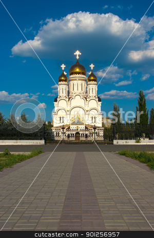 Road to a temple stock photo, Church with bright domes and crosses in the beautiful cloudy sky by Imaster