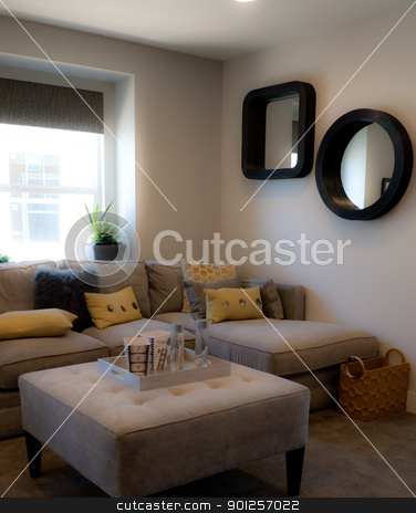 Living room stock photo, Small living room with sectional sofa by Cora Reed