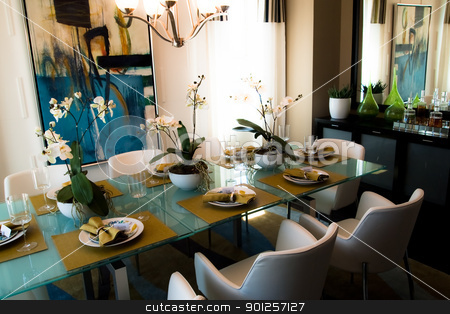 dining room stock photo, Modern flashy dining room with place settings on table by Cora Reed
