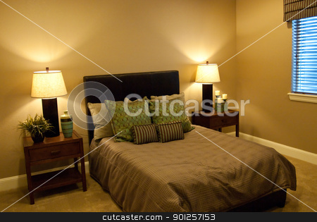 basement bedroom stock photo, Basement bedroom with very simple design and large window with valance by Cora Reed