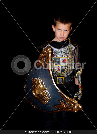 Child in a costume stock photo, Little boy in a dark knight costume with a shield by Cora Reed