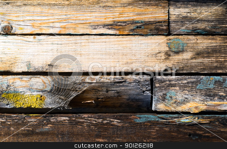 Weathered wooden plank stock photo, Stained and scratched weathered wooden a plank by Imaster