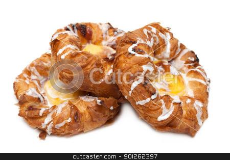 Three puff cakes with vanilla stock photo, Three puff cakes with vanilla on white background by Ruslan Kudrin