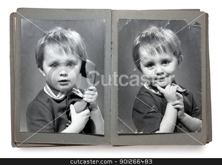 Vintage photoalbum stock photo, Old album with the children's shabby photos (isolated) by Imaster