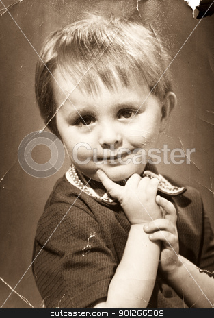 Vintage photo stock photo, Vintage photo. Tattered and shabby portrait of the little boy by Imaster