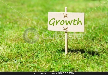growth stock photo, growth concept with word on nature still life by Gunnar Pippel