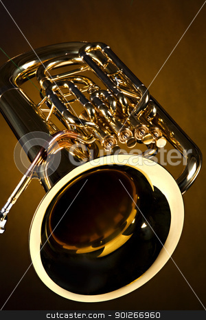 Tuba Euphonium Isolated on Gold stock photo, A gold color brass tuba euphonium isolated against a spotlight gold background in the vertical format. by Mac Milleer  (mkm3)