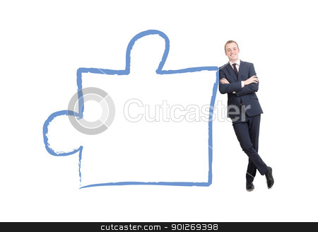 Business man stock photo, A business man leaning on a piece from a puzzle by Lasse Kristensen@gmail.com