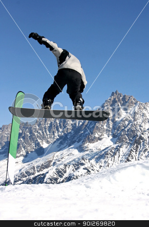 Snowboarder jumping stock photo, A snowboarder jumping freestyle in the mountains by Lasse Kristensen@gmail.com
