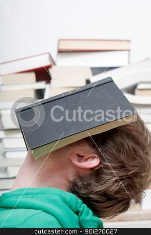 Man sleeping stock photo, A man sleeping behind a book by Lasse Kristensen@gmail.com