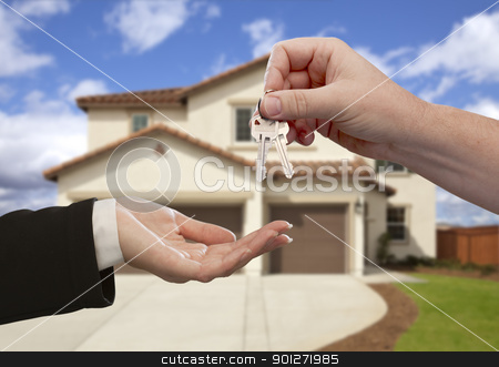 Handing Over the House Keys in Front of New Home stock photo, Handing Over the House Keys in Front of a Beautiful New Home. by Andy Dean