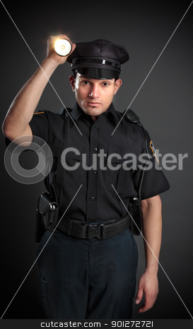 Policeman or Security Guard shining a torch stock photo, A policeman, night patrolman or security guard shining a flashlight torch to investigate or search. by Leah-Anne Thompson