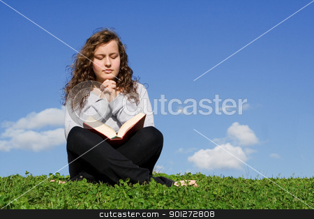 child or teen praying and reading bible outdoors stock photo, child or teen praying and reading bible outdoors by mandygodbehear