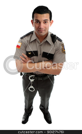 Prison Guard Warden or Policeman stock photo, A male prison guard warden or policeman in uniform with duty belt and radio unit.   Standing with arms crossed and looking up.  White background by Leah-Anne Thompson