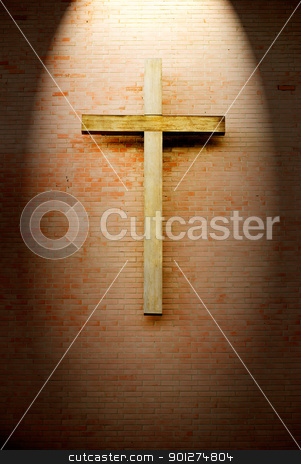 Wooden crucifix on the brick wall  stock photo, Wooden crucifix on the brick wall lighting by spotlight by Lawren