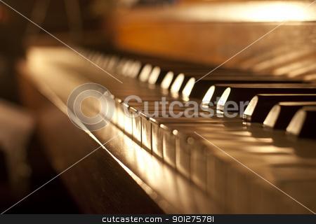 Piano keys stock photo, Piano keys on an antique piano played by The Buena Vista Social Club of Cuba by Christian Delbert