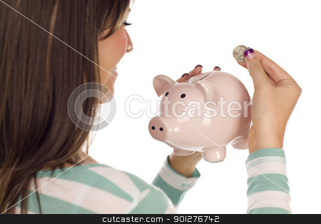 Ethnic Female Putting Coin Into Piggy Bank on White stock photo, Over Shoulder of a Pretty Smiling Ethnic Female Putting a Coin Into Her Pink Piggy Bank Isolated on a White Background. by Andy Dean