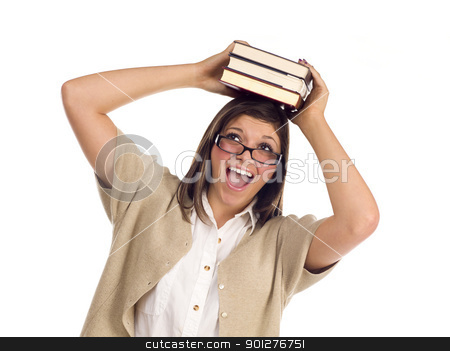 Ethnic Student with Books on Her Head Over White stock photo, Pretty Smiling Ethnic Female Student Holding Books On Her Head Isolated on a White Background. by Andy Dean