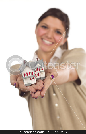 Ethnic Female with Small House on White stock photo, Pretty Smiling Ethnic Female Holding Out Small House in Front Isolated on a White Background - Focus is on the House. by Andy Dean