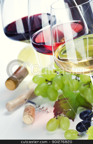 Glasses of white, red and rose wine and grapes  stock photo, Glasses of white, red and rose wine and grapes over white by klenova