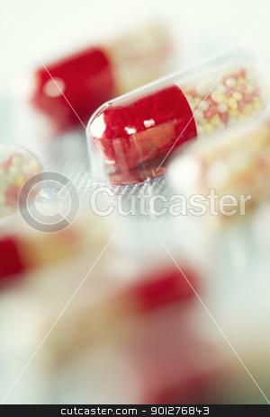 Close-up of capsules stock photo, Close-up of red capsules - selective focus by klenova