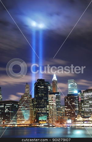 Remember September 11. stock photo, Remember September 11. New York City Manhattan panorama view at night with office building skyscrapers skyline illuminated over Hudson River and two light beam in memory of September 11. by rabbit75_cut
