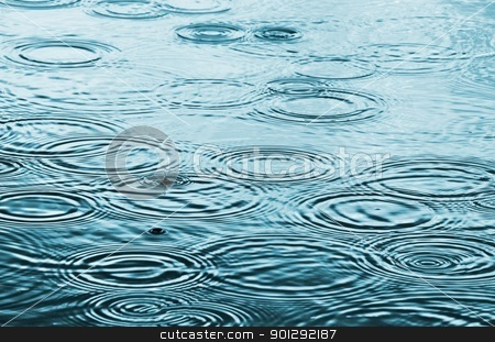 Rain stock photo, Rain drops on the water surface by Dutourdumonde
