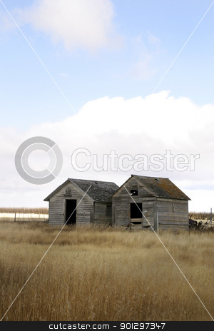 Weathered Grain Bins stock photo, Two wooden grain bins stand weathered on the saskatchewan prairie by Tyler Olson