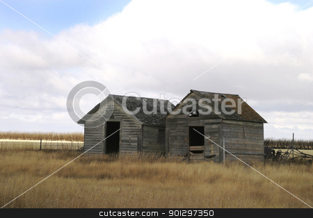 Two Old Grain Bins stock photo, Two old weathered grain bins on the saskatchewan horizon by Tyler Olson