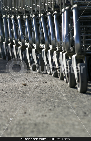 Shopping Carts stock photo, A row of shopping carts lined up by Tyler Olson