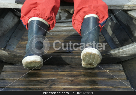 Rubber Boots stock photo, rubber boot detail in an old vintage fishing boat. by Tyler Olson