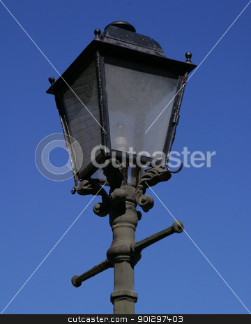 Lamp Post stock photo, A lamp post set against a blue sky by Tyler Olson