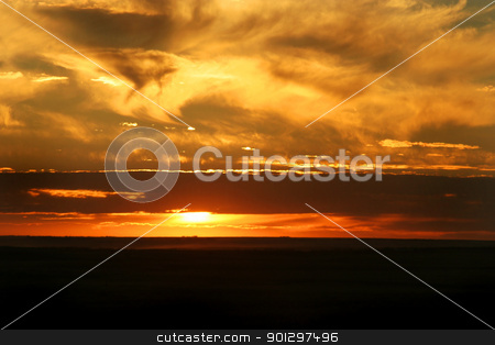 Saskatchewan Sunset stock photo, A red sky in a Saskatchewan sunset on the prairies by Tyler Olson