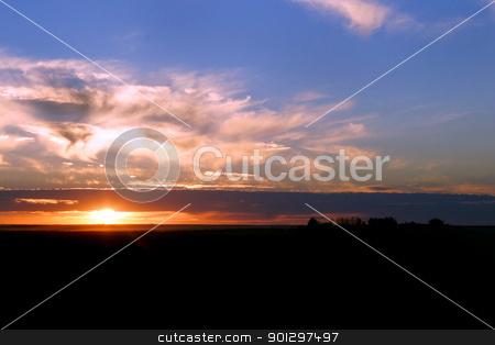 Prairie Sunset stock photo, A sun setting on a flat Saskatchewan landscape by Tyler Olson