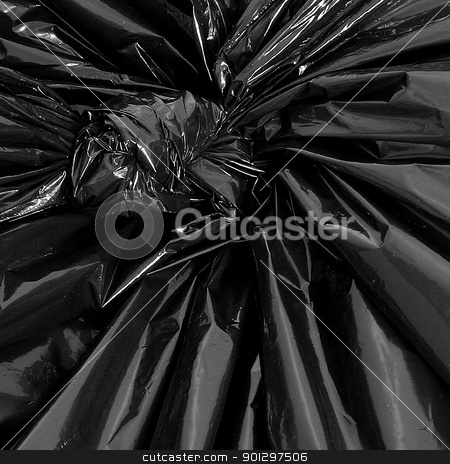Plastic Garbage Bag Detail stock photo, A plastic garbage bag with a knot detail by Tyler Olson