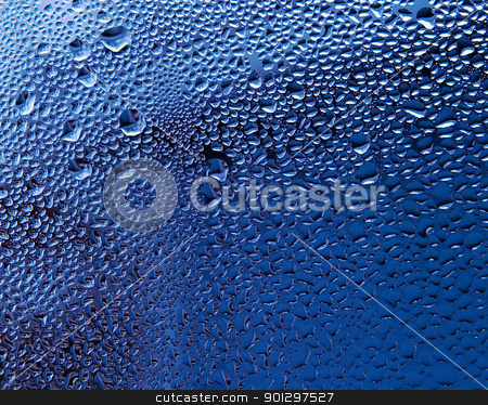 Water Droplet Texture stock photo, Water droplets on a plane of glass with a blue background by Tyler Olson