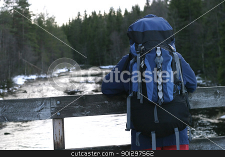 Backpacking stock photo, looking at a lake with a backpack on by Tyler Olson