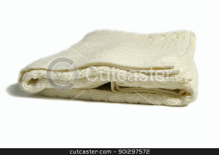 White Bathroom Towel stock photo, a white folded towel isolated on white by Tyler Olson