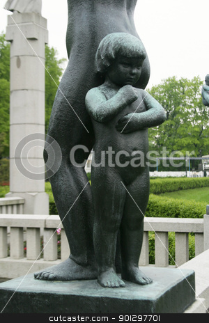 Little Shy Girl stock photo, Bronze sculpture of a little girl standing behind her mother at Vigeland Sculpture Park, Oslo Norway.  (Frognerparken)  by Tyler Olson