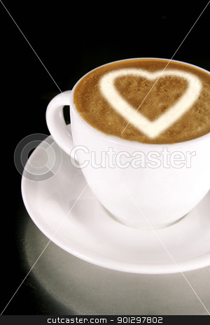 Heart on Coffee stock photo, A heart on a creamy cup of cappucinno by Tyler Olson