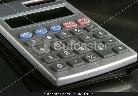 Calculator Detail stock photo, Small personal calculator detail with the on / off/ c buttons in focus by Tyler Olson