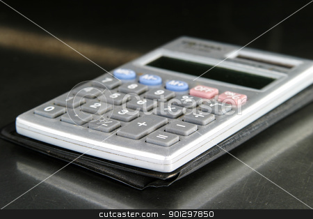 Calculator Detail stock photo, Small personal calculator detail with the equals sign in focus by Tyler Olson